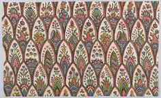 Polychrome print in black, purple, blue, green, yellow and reds on an off-white ground. Overlapping pointed arch forms contain a variety of floral and plant patterns.