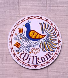 "The bird in this sign is the Bird of Paradise which symbolizes the beauty, wonder and mystery of life. The Pennsylvania Dutch ""Willkom"" (welcome) greets one and all and the heart adds a measure of love."