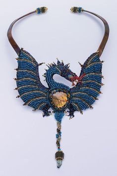 Bead Embroidery Dragon by BeadedNature, Materials: Labradorite, crystal, tourmaline crystal, beads, Ultrasuede, Copper, thread. Wow.