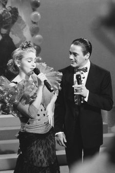 "But more importantly, she shared the stage with Robert Downey Jr.! | 11 Rare Photos Of Madonna Hosting ""SNL"""