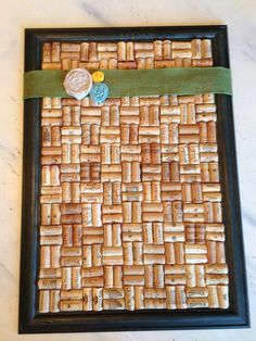 Cork board made from wine corks, a picture frame, and then some extra touches.