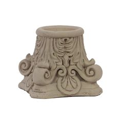 This elegant candle holder is crafted of cement and features rounded edges and intricate scroll work for a sophisticated aesthetic. Perfect paired with our favorite column candles, lend ambiance to your d�cor with this sandstone-finished candle holder.