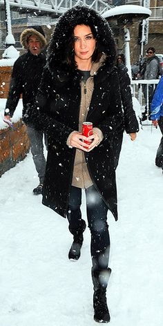 Emily Blunt at Sunsance.  Fur-trimmed Tory Burch coat and Nine West lace-up hiking boots.
