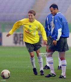 Brazilian midfielder Juninho Paulista (L) controls the ball as his captain Cafu looks on during a training session on the eve of Germany/Brazil final match of the 2002 FIFA World Cup, 29 June 2002 at Yokohama International Stadium.