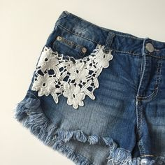"""⭐️HP⭐️ Jean Shorts with Lace Pockets Jean short from Mossimo Supply Co! Has crochet lace embellishments over the pockets! Cut off style jean shorts but has a hem so it won't fray up any higher! Size 7. About 30"""" waist and is slightly stretchy, 9"""" on the front from waist to hem, 2"""" inseam. 99% cotton 1% spandex. NO TRADES. Mossimo Supply Co. Shorts Jean Shorts"""