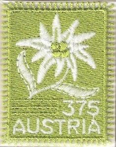 Austria embroidery stamp edelweiss - Austrian embroidery stamps featuring the Edelweiss and Clusius gentian flowers.  These stamps have been issued to commemorate the long lived embroidery industry in Austria which dates back to 18th century and the Alpine plans. I never knew that stamps can also be created using different materials.