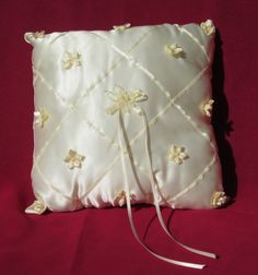 Ivory Satin Ring Bearer Pillow, crisscrossed with ribbon & accented with flowers #EnchantedWeddingSupplies
