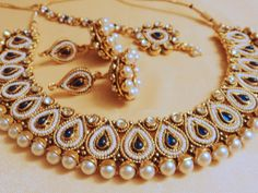 Gold pearl set necklace earrings