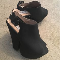 Steve Madden Peep-toe Wedges Black Steve Madden Peep-toe Platform Wedges. Buckle strap around the ankle. Only worn twice. In great condition! Steve Madden Shoes Platforms
