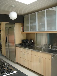 ikea kitchen in an eichler (This in white! Love the upper cabinets, and it even has my stainless steel countertop!)