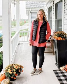 Sweater, vest puffer jacket, leggings and slip-on sneakers | For more style inspiration visit 40plusstyle.com