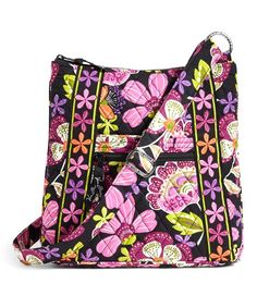 Equipped with versatile pockets, this bag secures all your essentials. An adjustable strap offers crossbody convenience, while the vibrant print exudes standout style. Note: This item features a retired pattern.