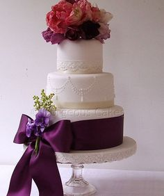 """Purple Parrot Tulips    Ivory fondant, lace, piped pearls and fresh flowers, finished with a wide satin bow.    4"""" 6"""" and 8"""" tiers serves up to 70"""