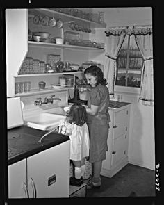 "1940s kitchen - open shelving -- I would love open shelving.  I'm too forgetful and end up ""hiding"" things in cabinets. ^_^"