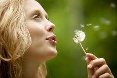 woman-blowing-dandelion