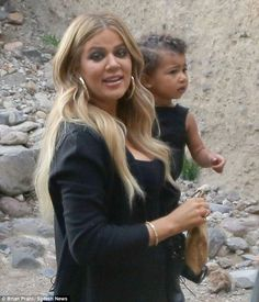 Love: The reality star carried her niece North West during their trip to Armenia in April
