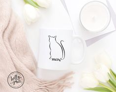The Meow Mug is for sophisticated cat lovers. The purrrrfect gift for your favorite crazy cat lady or crazy cat man.  This mug features a hand drawn cat silhouette with the word meow