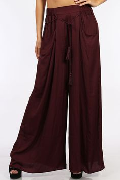 Up your game with these tall and wide burgundy wide-leg trousers. It's a gorgeous color, perfect for all seasons with this palazzo silhouette. Perfect with a crop top and your favorite leather slide s