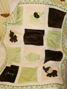Or should I get the elephant one?  Green 'n Brown Elephant Minky quilt by tlcblanketsandthings on etsy