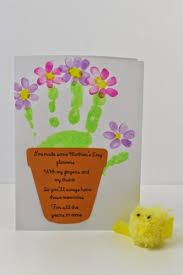 """Vatertag"" Mother's Day cards Children's handprint in green to make the base of the plant, then finger prints to make the petals. Super kids handprint craft Can Necklaces Mean a Pain in the Neck? Diy Mother's Day Crafts, Mother's Day Diy, Baby Crafts, Toddler Crafts, Holiday Crafts, Spring Crafts, Mothers Day Crafts For Kids, Fathers Day Crafts, Mothers Day Cards"