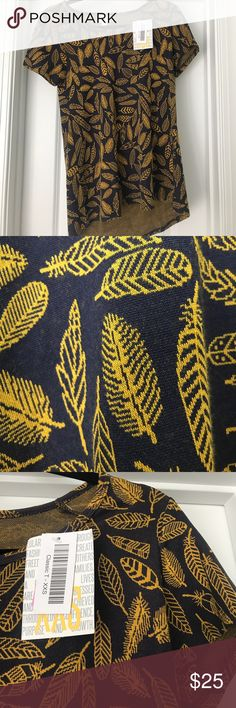 LuLaRoe Classic T - Sz xxs Gorgeous jacquard Classic T size xxs. Navy background with gold feathers. Never worn! Perfect for Fall! LuLaRoe Tops