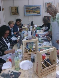 An assortment of people joined by the interest of painting. Paint parties are a great way to either catch up with old friends, or get to know new ones!