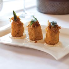 Hearty fried Boudin with ravigote sauce & caramelized onions served up ...