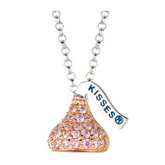 Designed in Sterling silver with pink Cubic Zirconium , this Small Flat Back Hershey's Kiss October Pendant includes an 16 inches with 2 inch extension Rolo chain with Lobster claw.