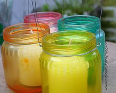 Baby food jars, colored, and used as voltive holders.   I bet I could do this with canning jars too, and they'd make nice centerpieces...