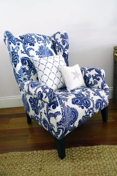 Wing chair upholstered in a blue and white Jacobean print fabric. I love the crispness!