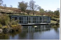 Cove Park, Scotland, shipping container home  with an earthen roof