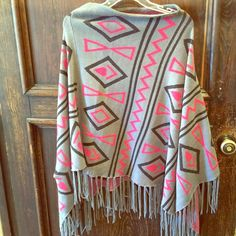 NWOT Francesca's collections poncho Very cute and trendy poncho from Francesca's closet! I took the tags off and only wore once like a blanket scarf. Fits more like a large. Francesca's Collections Sweaters Shrugs & Ponchos