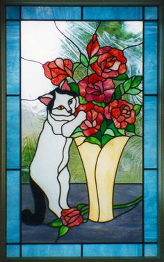 Bad kitty...caught in stained glass