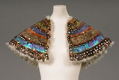This breathtaking feather pelerine dates to circa 1830