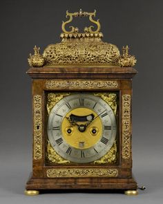 JAMES MARKWICK, London c1695 A fine William and Mary quarter repeating spring table clock veneered with kingwood. The flamboyant case stands on brass bun feet with repoussé mounts to the door and a repoussé basket top supporting the carrying handle. The basket is flanked to the four corners with unusual four leaf finials. The 7 in (18 cm) square dial is mounted with wing cherub spandrels and silvered chapter ring with strike/silent option above.