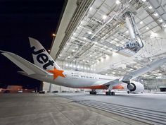 Jetstar Pacific's first Boeing 787-8 Dreamliner being rolled out of the paint hangar