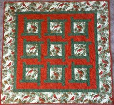 Fusible Applique Makes This Quilt Easier Than it Looks! While we love winter, the whites and browns of the landscape can become tiring after awhile. It's always a treat to see colorful cardinals settling in the trees and adding a splash of color. This quilt by Prairie Grove Peddler brings the colors of cardinals in …