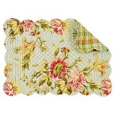 """Bring a pop of style to your dining room with this eye-catching quilted placemat, showcasing a floral motif and scalloped edges.   Product: PlacematConstruction Material: CottonColor: MultiFeatures: Scalloped edge Quilted designReversibleDimensions: 13"""" x 19"""""""