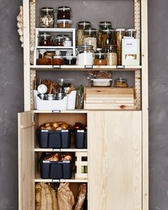 A wooden storage pantry to keep you organized in the kitchen and waste less food. That's #SustainableLiving #lifeathome