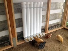 Rockin' pipe feeders.  I really like these . . . and we could have the pipe outside of the coop, with the bend going through the wall.