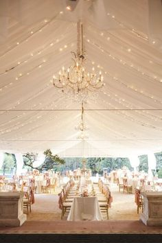 Beautiful Blush & White tent with chandelier