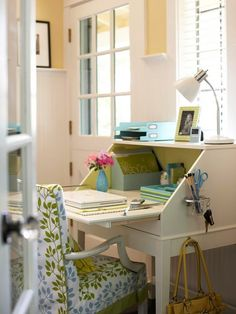 Fold-up desk with cute fabric chair.  Want a small one like this for the corner of my bedroom.  This one came from IKEA.  They painted the inside and added some cute hooks.
