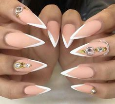 Love matte peachy/nude v-shape French stilettos nails minus all those rhinestones