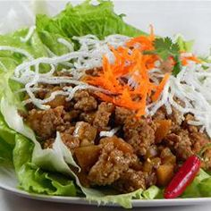 Asian Lettuce Wraps | Ground beef seasoned with soy and hoisin sauces, garlic, ginger, and green onions is gently folded into fresh lettuce leaves to be eaten burrito style.