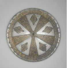 Parade shield,  North Italy, possibly Milan,  c. 1570 - c. 1575,  Steel and gold, etched and gilded,  Diameter: 56.5 cm,  Weight: 3.59 kg
