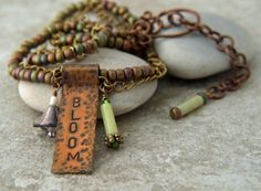 Another one of my inspirational banner necklaces. $32.00    This banner is hand forged, stamped, antiqued, sanded and tumbled for a warm copper look.    I played it up with a combination of chain and metallic seed beads.    Length is adjustable from15 inches to 18.5 inches, 38cm to 47cm.    Comes with a gift box ready for giving.    You can follow my creative process here: