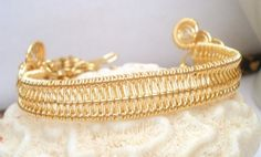 Gold color wire woven cuff handmade wire wrapped bangle bracelet. $38.00, via Etsy.