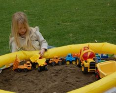 Fill an inflatable pool with top soil to let the kids play... I may use my embarrassingly empty raised garden bed!