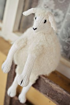 """At petitepurls.com:  FREE knitting pattern ~ Have Ewe Any Wool?  by Chris de Longpré, who writes """"My whimsical stuffed ewe came to life as the result of the many, many requests I've received over the years to create a sheep.""""  7"""" tall when seated.  Chris publishes patterns under the trade name """"Knitting at KNoon Designs, LLC"""".  Pattern copyright 2011.  Photo by Brandy Fortune."""