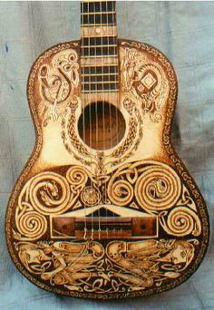 So many loves in one piece - guitar, pyrography and Celtic knotwork.